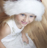 Child with fluffy santa hat — Stock Photo