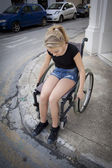 Person in wheelchair trying to cross the road — Stock Photo