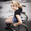 Child in wheelchair — Stock Photo #35666335