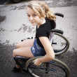 Child in wheelchair — Stock Photo