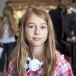 Teenage girl in airport travelling — Stock Photo #35757729