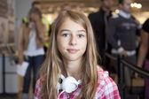 Teenage girl in airport travelling — Stock Photo