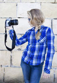 Cool kid holding a camera taking a photo of herself — Stock Photo