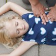 Stock Photo: Young child receiving first aid