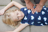 Young child receiving first aid — ストック写真
