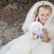 First holy communion girl with dress, veil and candle — Stock Photo