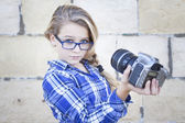 Girl holding camera taking self portrait — Stock Photo