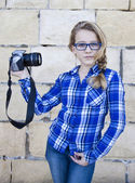 Girl holding camera snapping a selfie — Stock Photo