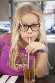 Child with drink and straw — Stock Photo
