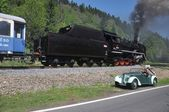 Special steam train and old timer car — Stock Photo
