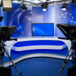TV studio with camera and lights — Stock Photo #27347969