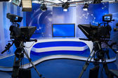 TV studio with camera and lights — Stock Photo