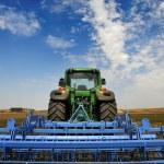 The Tractor - modern farm equipment in field — Stockfoto #28174667