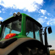 The Tractor - modern farm equipment in field — Stockfoto