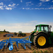 The Tractor - modern farm equipment in field — Stock Photo #28174581