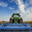 The Tractor - modern farm equipment in field — Stock Photo #28174667