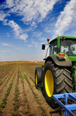 The Tractor - modern farm equipment in field — ストック写真