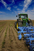 The Tractor - modern farm equipment in field — Stock Photo