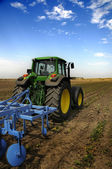 The Tractor - modern farm equipment in field — Stok fotoğraf