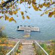 Autumn on the River, boat and yellow foliage, footbridge — Stock Photo