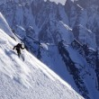 Stock Photo: Man skiing a steep slope in Alaska's Chugach Mountains during a heli-ski trip
