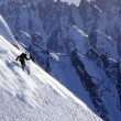 Stock Photo: Mskiing steep slope in Alaska's Chugach Mountains during heli-ski trip