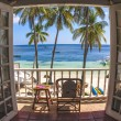 Room with a tropical beach view and balcony with bamboo furniture — Foto de Stock
