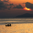 Local sea gypsies paddling a canoe in the Celebes Sea near the island of Mabul in Sabah, Malaysia. — Stock Photo