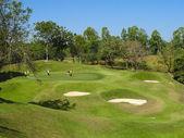 PATTAYA, THAILAND - DECEMBER 28: Unidentified senior men playing golf on a scenic golf course near Pattaya, Chonburi on December 28, 2010. — Stock Photo