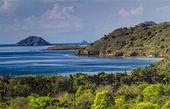 Green mountains near the ocean — Stock Photo