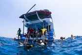 Scuba divers climbing back on dive boat in Similn Islands, Thailand — Stock Photo