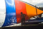Traditional Balinese fishermen setting colorful sail — Stock Photo
