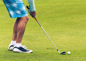 Closeup of of golfer putting on green — Stock Photo