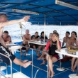 Stock Photo: Dive instructor and student writing log books