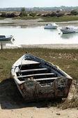 Beached fishing boat ashore — Stock Photo