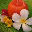 Stock Photo: Frangipani Flower and Candle