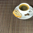 Cup of coffee and biscotti — Stock Photo
