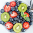 Mixed berries and kiwi fruit — Stock Photo
