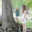 Girl playing with mother in the park — Stock Photo