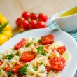 Farfalle pasta with cherry tomatoes — Stock Photo #32494587