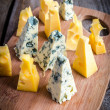 Pieces of emmental and blue cheese — Zdjęcie stockowe #38800299