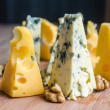 Pieces of emmental and blue cheese — Stockfoto #38800351