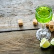 Stock Photo: Glass of absinwith lime and sugar cubes