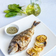 Grilled dorada fish with lemon and spinach — Stock Photo #39720985