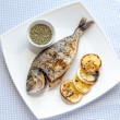 Grilled dorada fish with lemon and spinach — Stock Photo #39720989