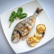Grilled dorada fish with lemon and spinach — Stock Photo #39720991