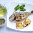Grilled dorada fish with lemon and spinach — Stock Photo #39721005