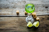 Glass of absinthe with lime and sugar cubes — Stock Photo
