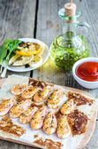 Shrimps with lemon and spicy sauce on the wooden background — Стоковое фото