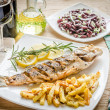 Stock Photo: Baked seabass with fried potatoes
